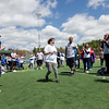 Leominster's Sammy O'Callaghan is cheered on by volunteers and teammates as she competes in the Special Olympics at Fitchburg State's Elliot Field on Friday morning. SENTINEL & ENTERPRISE / Ashley Green