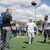 Leominster's Brian Petkewich spikes the football while competing in the Special Olympics at Fitchburg State's Elliot Field on Friday morning. SENTINEL & ENTERPRISE / Ashley Green