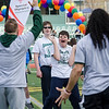Oakmont's Matthew Thorp throws the football through a hoop held at Fitchburg State hockey players Nick Govig and Nat Rojas during the Special Olympics at FSU's Elliot Field on Friday morning. SENTINEL & ENTERPRISE / Ashley Green