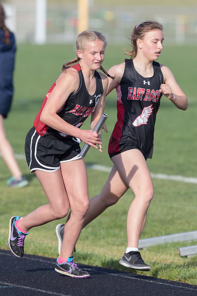 Jasmine Shelton receives the handoff from  Frances Marshburn in the girls 4x800 relay.