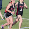 Jasmine Shelton receives the handoff from  Frances Marshburn in the girls 4x800 relay.