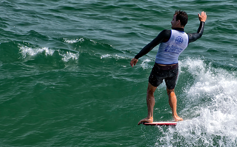 Hanging ten friendly wave How Ya Doing