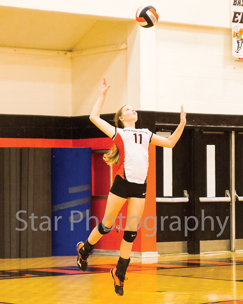 Star Photo/ Larry N. Souders<br /> Lady Cyclone freshman Morgan Smith (11) delivers a jump serve for an ace in first game of Thursday nights match against the Lady Patriots of Sullivan East.