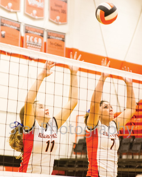 Star Photo/ Larry N. Souders<br /> Elizabethton's Morgan Smith (11) and Cassidee Ray (7) go up to block a shot against the Lady Patriots of Sullivan East Thursday night.