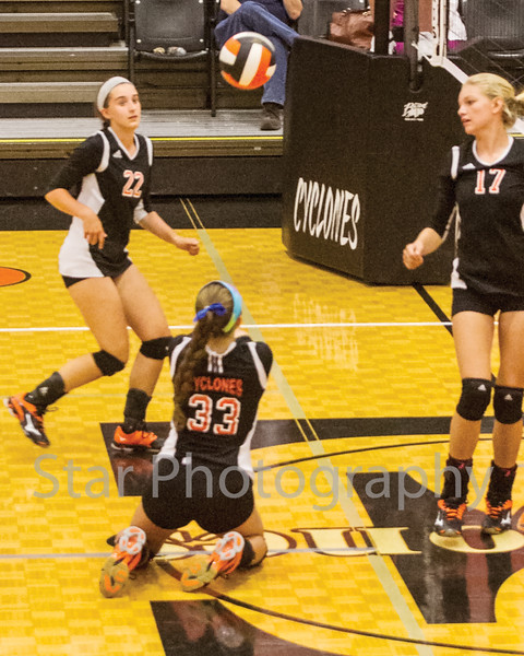 Star Photo/Larry N. Souders<br /> The VJ Lady Cyclones'  Danielle Martin (33) hits the deck to digs spike from a Lady Blue Devil of Unicoi Tuesday night match at Elizabethton High School.