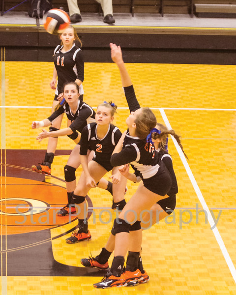 Star Photo/Larry N. Souders<br /> With a number of her Lady Cyclones team mates looking on Carly White (3) drive home a kill in the first match against Unicoi Tuesday night.