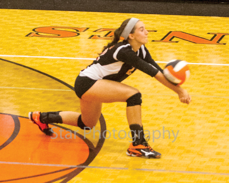 Star Photo/Larry N. Souders	<br /> The VJ Lady Cyclones' Macey Burleson (22) digs for a return shot spike during Tuesday nights match against the Lady Blue Devil of Unicoi.