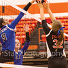 Star Photo/Larry N. Souders<br /> The Lady Cyclones Sydney Goodsell (23) goes up and blocks a spike from a Lady Blue Devil of Unicoi Tuesday night match at Elizabethton High School.