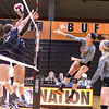 Star Photo/Larry N. Souders<br /> Milligan's Charlie Bateman (4) fires a kill shot between two Lady Bears from Truett-McConnell.