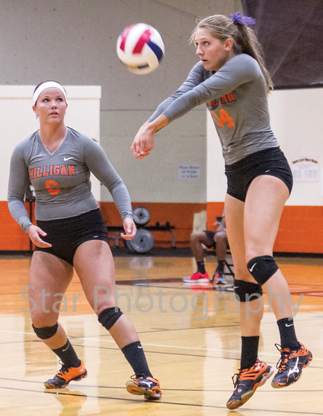 Star Photo/Larry N. Souders<br /> With Milligan's Jadin Foster (6) looking on Samantha Bruinius (14) sets a shot back to the net.