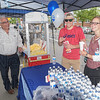 Steve St Peter of Re/Max Realty serves up some popcorn to Zach Pietras and Chloe Forrant.