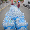 A sea of water bottles awaits the runners, handed out by Aimee Tompkins and Deb Scanlon of Park Square Realty.