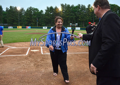 6/3/2016 Mike Orazzi | Staff  Maria Salice hand the microphone to Bristol Blues General ManagerRick Muntean after singing the Star Spangled Banner during the home opener of the Bristol Blues at Muzzy Field Friday night.