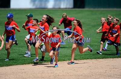 7/19/2016 Mike Orazzi | Staff Children from local camps participate a stampede during the Bristol Blues Game with the Brockton Rox at Muzzy Field on Tuesday.
