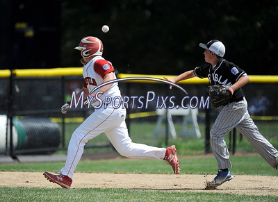 8/13/2016 Mike Orazzi | Staff Connecticut's Richie Kerstetter (14) and Rhode Island's Domenic Brazeau (12) during the New England Final at the Eastern Regional Little League Tournament in Bristol Saturday afternoon. Warwick North defeated Fairfield American 5-1 to advance to the Little League World Series.