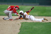 5/14/2016 Mike Orazzi | Staff<br /> New Britain's Jakari Pellegrini (4) being tagged out by Berlin's Jake Loiselle (1) at at second base Saturday at Bee Hive Stadium in New Britain.