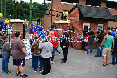 6/3/2016 Mike Orazzi | Staff  Bristol Blues General Manager Rick Muntean directs fans at the home opener of the Bristol Blues at Muzzy Field Friday night.