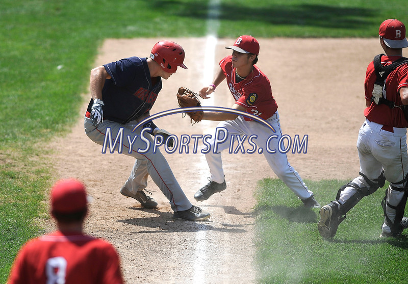 8/5/2016 Mike Orazzi | Staff<br /> Bristol American Legion's Cory Fradette (2) runs down New Hampshire's Justin Jewell (17) at third during the Northeast Regional American Legion Baseball Tournament in Bristol Friday.
