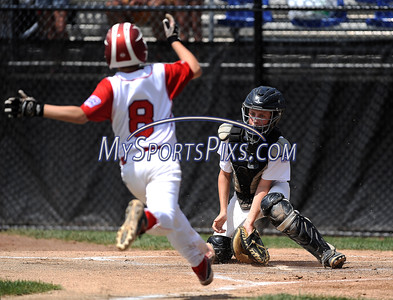 8/12/2016 Mike Orazzi   Staff Connecticut's Sean McAdams (8) as Massachusetts' David Blair (7) prepares to tag him out during the Eastern Regional Little League Tournament at Breen Field Friday.