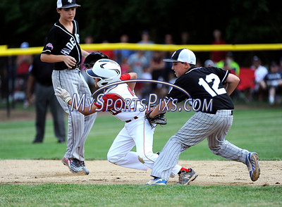 8/13/2016 Mike Orazzi | Staff Rhode Island's Domenic Brazeau (12) tags Connecticut's Michael Innaimo (3) during the New England Final at the Eastern Regional Little League Tournament in Bristol Saturday afternoon. Warwick North defeated Fairfield American 5-1 to advance to the Little League World Series.
