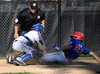 8/7/2016 Mike Orazzi | Staff<br /> New Jersey's Jonathan Olik (24) scores as New York's Conner Rush (23) applies the tag during the Eastern Regional Little League Tournament in Bristol Sunday.