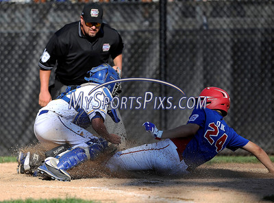 8/7/2016 Mike Orazzi | Staff New Jersey's Jonathan Olik (24) scores as New York's Conner Rush (23) applies the tag during the Eastern Regional Little League Tournament in Bristol Sunday.