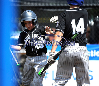 8/13/2016 Mike Orazzi | Staff Rhode Island's Dylan Bourret (15) and Colin Lemieux (14) during the New England Final at the Eastern Regional Little League Tournament in Bristol Saturday afternoon. Warwick North defeated Fairfield American 5-1 to advance to the Little League World Series.