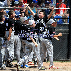 8/13/2016 Mike Orazzi | Staff Rhode Island's players celebrate Colin Lemieux (14) after his home run during the New England Final at the Eastern Regional Little League Tournament in Bristol Saturday afternoon. Warwick North defeated Fairfield American 5-1 to advance to the Little League World Series.