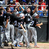 8/13/2016 Mike Orazzi | Staff<br /> Rhode Island's players celebrate Colin Lemieux (14) after his home run during the New England Final at the Eastern Regional Little League Tournament in Bristol Saturday afternoon. Warwick North defeated Fairfield American 5-1 to advance to the Little League World Series.