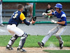 6/4/2016 Mike Orazzi | Staff<br /> Bristol Eastern's Brian McPhee (13) tagged out by East Haven's Sam Loda (13) during a BE win in the Class L Quarterfinal at Muzzy Field Saturday.