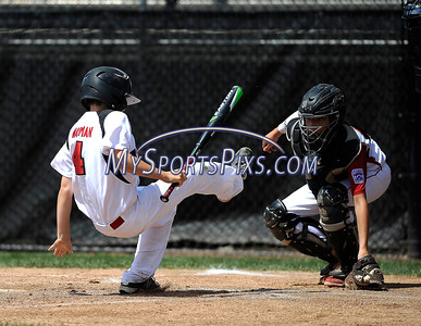 8/12/2016 Mike Orazzi   Staff Massachusetts' Quinn Wayman (4) hit by a pitch during the Eastern Regional Little League Tournament at Breen Field Friday.