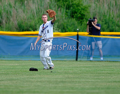 6/4/2016 Mike Orazzi | Staff St. Paul's Jackson Hines (11) after a diving catch in center field during the Class S Quarterfinal with Portland High School in Bristol Saturday.