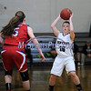 2/17/2016 Mike Orazzi | Staff<br /> Bristol Central's Meghan Hamel (15) and Berlin's Angela Perrelli (5) Wednesday night at Central.
