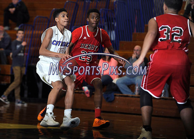 1/19/2016 Mike Orazzi | Staff St. Paul's Donavan Symes (15) and Derby's Isaiah Walker (25).