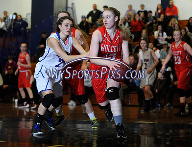 1/29/2016 Mike Orazzi | Staff St. Paul's Lizzy Cretella (21) and Wolcott's Briana Japs (15).