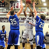 1/22/2016 Mike Orazzi | Staff<br /> Bristol Central's Tamir Hornesby (34) and Bristol Eastern's Tyler Tefoe (35) and Jake Violette (20).