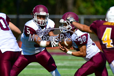 9/17/2016 Mike Orazzi | Staff Bristol Central's Isaiah Miller (5) and Luis Medina (32) in South Windsor on Saturday.