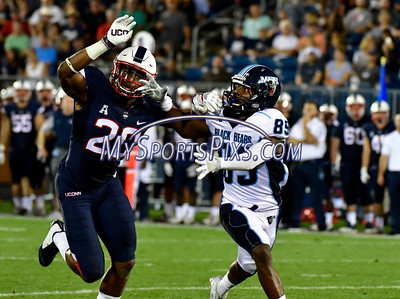 9/1/2016 Mike Orazzi | Staff UConn's Obi  Melifonwu (20) and the Maine Black Bears' Marquise Adams (89) during a 24-21 UConn win at Rentschler Field in East Hartford Thursday night in the season opener.