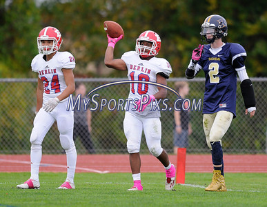 10/8/2016 Mike Orazzi | Staff Berlin's Larry St. Pierre Jr. (10) after a TD with Alejandro Bonilla (24) and the RHAM Sachems' Jack Tillinghast (2) in Hebron Saturday.