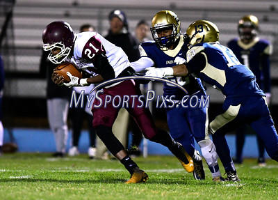 11/4/2016 Mike Orazzi | Staff Bristol Central's Ed Irizarry (21) and Newington's Corey Pertillar Jr. (22) and Luke Pappalardo (13) Friday night in Newington.