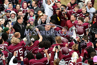 11/24/2016 Mike Orazzi | Staff Bristol Central Football Coach Jeff Papazian celebrates by ringing the bell after a win over Bristol Eastern during the annual Battle for the Bell at Muzzy Field Thursday.