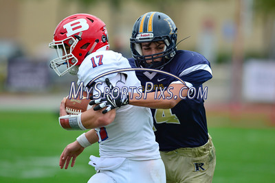 10/8/2016 Mike Orazzi | Staff Berlin's Jack Hamel (17) and RHAM's Jeremy Boy (14) during Saturday's football game in Hebron.