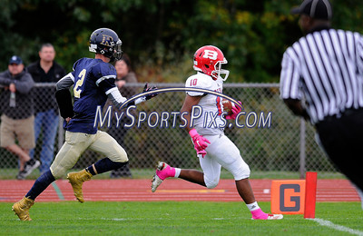 10/8/2016 Mike Orazzi | Staff Berlin's Larry St. Pierre Jr. (10) on his way to a TD followed by the RHAM Sachems' Jack Tillinghast (2) in Hebron Saturday.