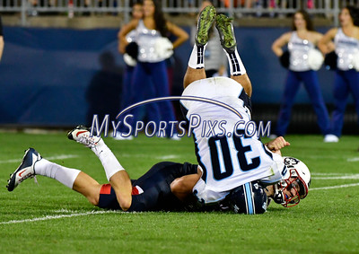 9/1/2016 Mike Orazzi | Staff UConn's Bryant Shirreffs (4) and the Maine Black Bears' Austin Brown (30) during a 24-21 UConn win at Rentschler Field in East Hartford Thursday night in the season opener.