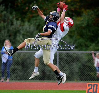 10/8/2016 Mike Orazzi | Staff Berlin's (4) not on the roster and the RHAM Sachems' Jeremy Boy (14)  in Hebron Saturday.