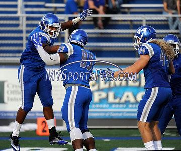 9/2/2016 Mike Orazzi | Staff  CCSU's Kenneth Keen (9), Brandon Puritt (95) and Seth Manzanares (44) in New Britain Friday night.