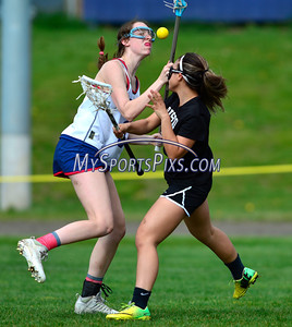 4/22/2016 Mike Orazzi | Staff S. Paul Catholic High School's Steph Speaker (3) and Bristol Co-op girls lacrosse's Aly Policarpio (4)  Friday afternoon in Bristol.