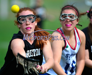 4/22/2016 Mike Orazzi | Staff Bristol Co-op girls lacrosse's Brianna Hamel (9) and and St. Paul Catholic High School's Amethyst Peterson (16) Friday afternoon in Bristol.