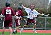 4/23/2016 Mike Orazzi | Staff<br /> Canton's John Graziano (15 and Bristol Central's Nick Gagnon (13) during lacrosse Saturday at BCHS.