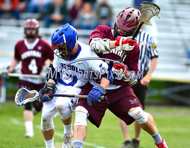 5/18/2016 Mike Orazzi | Staff St. Paul's Chris Dionne (7) and Bristol Central's Connor Staubley (12).
